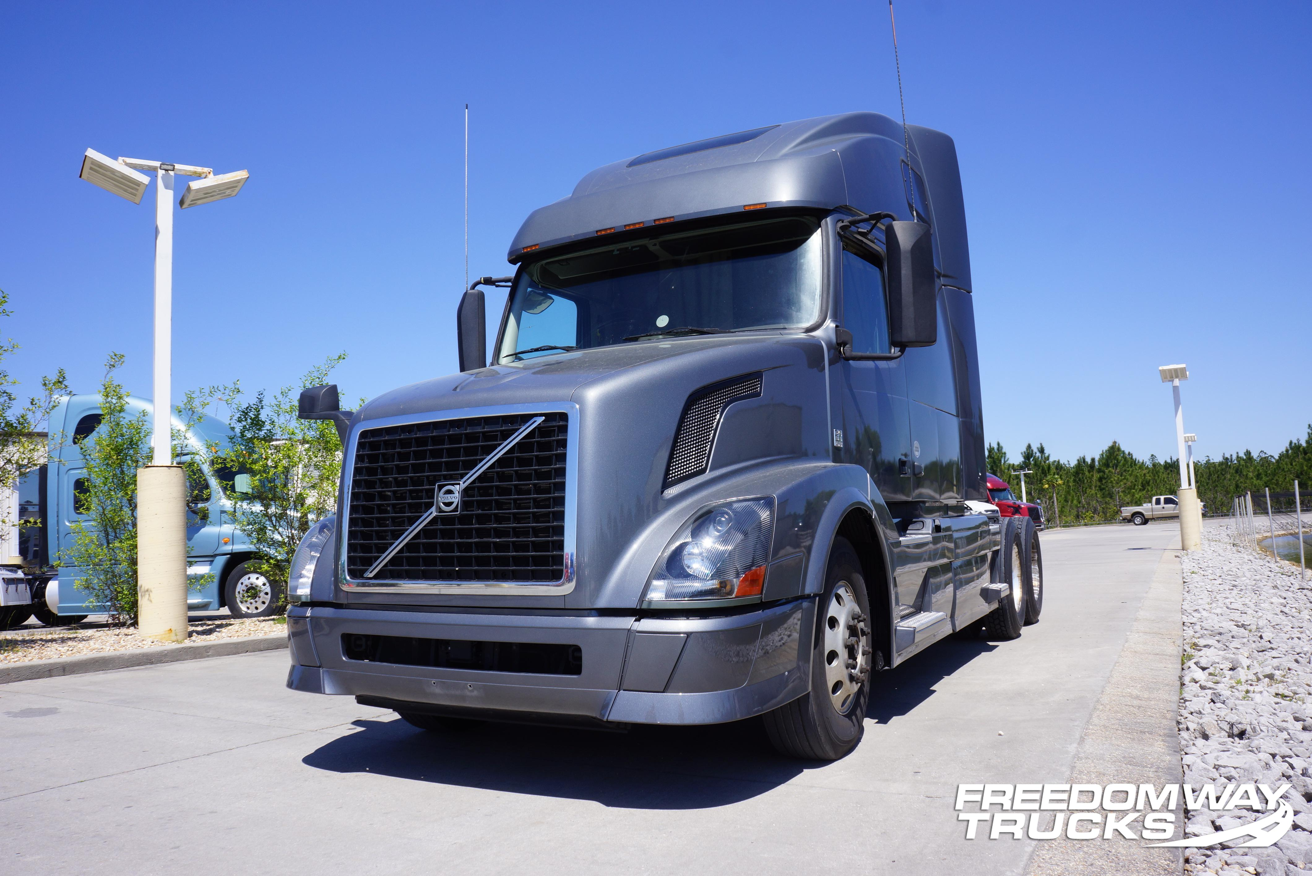 USED 2014 VOLVO 670 DAYCAB TRUCK #142041